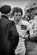 Mario Andretti, newly-crowned 1978 Formula One World Driving Champion, answers questions accompanied by Colin Chapman, founder of Lotus and team principle of the John Player Special Team Lotus-Ford. <br />