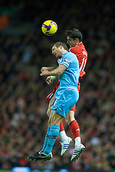 LIVERPOOL, ENGLAND - Monday, December 1, 2008: Liverpool's Albert Riera and West Ham United's Lucas Neill during the Premiership match at Anfield. (Photo by David Rawcliffe/Propaganda)