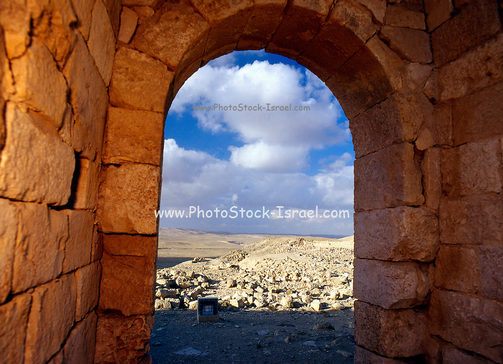 An arched door way, at Ovdat, Israel The ruins at Avdat or Ovdat, the remains of a Nabateans road station for their caravans, is located on a mountain in the center of the Negev Desert on the road from Petra and Eilat.