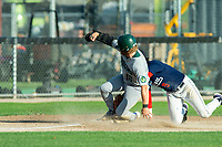 KELOWNA, BC - JULY 24:  Third baseman, Matt Voelzke #5 of the Kelowna Falcons, tags Nick Israel #10 of the Yakima Valley Pippins as he slides into third base at Elks Stadium on July 24, 2019 in Kelowna, Canada. (Photo by Marissa Baecker/Shoot the Breeze)