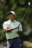 Tiger Woods of the US watches the flight of his second shot on the sixth hole during the first day of the US Open Golf Championship at Winged Foot Golf Club in Mamaroneck, New York Thursday, 15 June 2006.