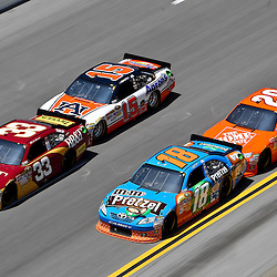 April 17, 2011; Talladega, AL, USA; NASCAR Sprint Cup Series driver Clint Bowyer (33) leads Kyle Busch (18), Michael Waltrip (15) and Joey Logano (20) during the Aarons 499 at Talladega Superspeedway.   Mandatory Credit: Derick E. Hingle