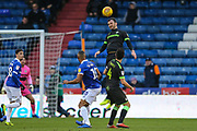 Forest Green Rovers Gavin Gunning(16) heads the ball clear during the EFL Sky Bet League 2 match between Oldham Athletic and Forest Green Rovers at Boundary Park, Oldham, England on 12 January 2019.