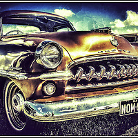 Vintage retro classic car in gold with texture and grain