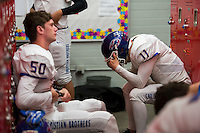 Christian Brothers High School Falcons Matt Marengo (11),reacts inside the locker room after their 51-14 loss to the Oakdale Mustangs in the Sac-Joaquin Section Division III championship football game at Lincoln High School in Stockton CA,  Friday Dec 2, 2016.<br /> photo by Brian Baer