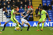 Birmingham City midfielder Stephen Gleeson and Huddersfield Town defender Tommy Smith battle during the Sky Bet Championship match between Birmingham City and Huddersfield Town at St Andrews, Birmingham, England on 5 December 2015. Photo by Alan Franklin.