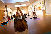 """Participants in the weekly Yoga in Faulconer Gallery group practice a meditative """"mudra"""" or gesture on Thursday in the Bucksbaum Center for the Arts."""