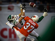 Saskatchewan Roughriders' Chris Getzlaf is prevented by BC Lions David Hyland from catching a pass during CFL play in Vancouver, BC. (2010)