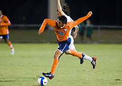 Virginia Cavaliers midfielder Jonathan Villanueva (10) gets tangled with an SMU defender.  The #18 ranked Virginia Cavaliers fell to the #14 ranked Southern Methodist Mustangs 3-1 in NCAA men's soccer at Klockner Stadium on the Grounds of the University of Virginia in Charlottesville, VA on August 31, 2008.