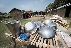 16 September 2018, Sirsiya Tole, Jahada rural municipality, Nepal: Pots and pan lie to dry in the sun outside a home in Sirsiya Tole, a community inhabited by Santal and Dalit (Musahar) people, who find themselves as the very margin of society in Nepal. Through support from the Nepal Evangelical Lutheran Church, the community has been able to recover and develop flood resilience, and to mobilize to make their voices heard in the local government, as Nepal is transitioning into a federal government system.