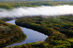 CANADA ALBERTA FORT MCMURRAY 28SEP09 - Ground fog over the river Athabasca during early morning, north of Fort McMurray, northern Alberta, Canada...The tar sand deposits lie under 141,000 square kilometres of sparsely populated boreal forest and muskeg and contain about 1.7 trillion barrels of bitumen in-place, comparable in magnitude to the world's total proven reserves of conventional petroleum. Current projections state that production will  grow from 1.2 million barrels per day (190,000 mÃ?âEUR?Ã,³/d) in 2008 to 3.3 million barrels per day (520,000 mÃ?âEUR?Ã,³/d) in 2020 which would place Canada among the four or five largest oil-producing countries in the world...The industry has brought wealth and an economic boom to the region but also created an environmental disaster downstream from the Athabasca river, polluting the lakes where water and fish are contaminated. The native Indian tribes of the Mikisew, Cree, Dene and other smaller First Nations are seeing their natural habitat destroyed and are largely powerless to stop or slow down the rapid expansion of the oil sands development, Canada's number one economic driver...jre/Photo by Jiri Rezac / GREENPEACE..© Jiri Rezac 2009