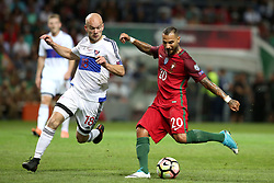 August 31, 2017 - Porto, Portugal - Portugal's forward Ricardo Quaresma vies with Faroe Islands' midfielder Karl Lokin (L) during the 2018 FIFA World Cup qualifying football match between Portugal and Faroe Islands at the Bessa XXI stadium in Porto, Portugal on August 31, 2017. (Credit Image: © Pedro Fiuza/NurPhoto via ZUMA Press)