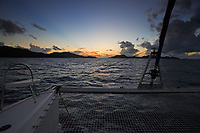 view from a sailling boat of a sunset on saint anne 's bay inpraslin seychelles islands indian ocean