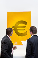 Male executive looking at Euro sign over white background.