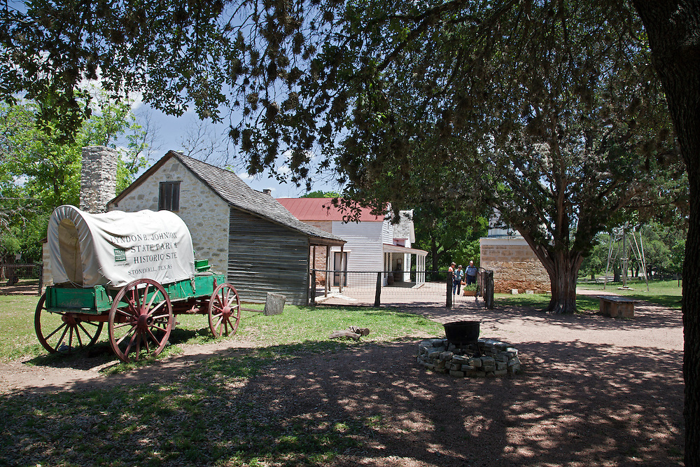 """Two original homes form the heart of the Sauer-<br /> Beckman Living History Farm.  The first began as a one-room log cabin in 1869, plus later additions, and the second is a Prairie-style Victorian, circa 1915.  The latter's walls range from hill country rock and clapboard siding to pressed tin, a """"whatever works"""" type of construction typical of its time."""