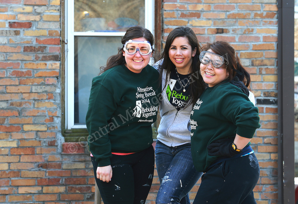 (Left to Right) Jill Prior, of Grand Rapids, Emily Coleman, of Taylor, and Elaine Trinh, of Grand Rapids were among ten Central Michigan University students who spent their Alternative Break week volunteering with Rebuilding Together, an urban renewal experience, in Pittsburgh, PA. Their urban renewal experience gave them hands on experience working on homes and making repairs. Photo by Steve Jessmore/Central Michigan University