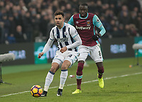 Football - 2016 / 2017 Premier League - West Ham United vs. West Bromwich Albion<br /> <br /> Hal Robson Kanu of West Bromwich Albion watched by Cheikhou Kouyate of West Ham at the London Stadium.<br /> <br /> COLORSPORT/DANIEL BEARHAM