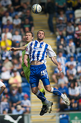COLCHESTER, ENGLAND - Saturday, April 24, 2010: Tranmere Rovers' Ian Thomas-Moore and Colchester United's John White in action during the Football League One match at the Western Community Stadium. (Photo by Gareth Davies/Propaganda)