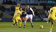 Joe Martin looks to beat his man during the Johnstone's Paint Trophy semi final first leg match between Millwall and Oxford United at The Den, London, England on 14 January 2016. Photo by Michael Hulf.