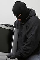 Burglar stealing television set