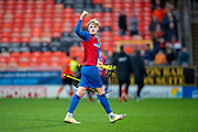 Coll Donaldson (#5) of Inverness Caledonian Thistle FC gesticulates toward the Dundee United fans after the final whistle of the William Hill Scottish Cup quarter final match between Dundee United and Inverness CT at Tannadice Park, Dundee, Scotland on 3 March 2019.