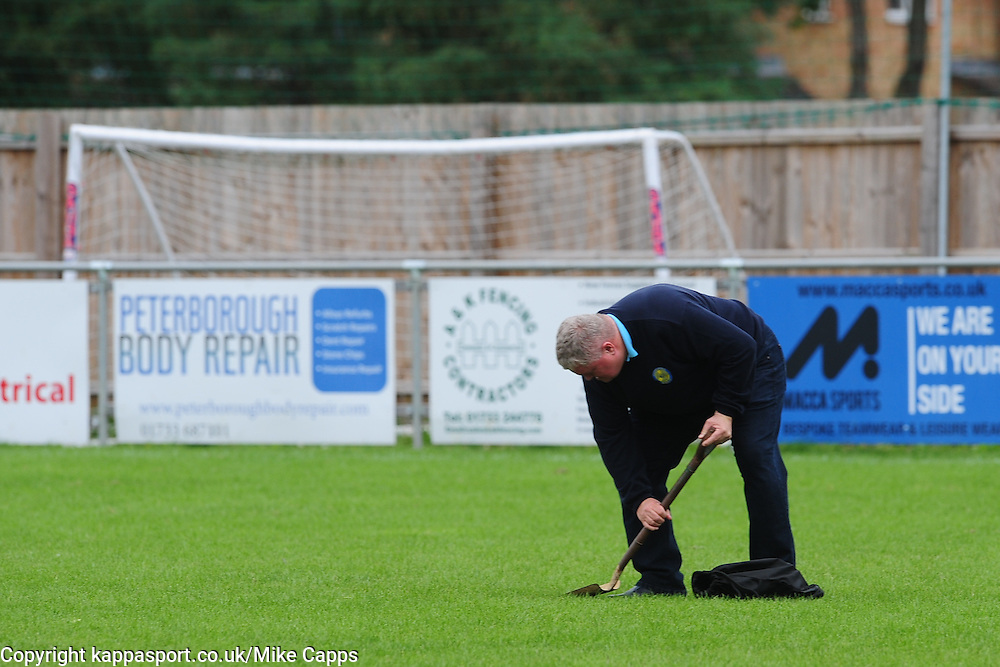 PERTERBOROUGH SPORTS CHAIRMAN STEPHEN THOMAS COOPER CLEANS THE PITCH OF FOXES DROPPINGS, Peterborough Sports FC v Newport Pagnell FC Ucl Premier Division League Saturday 17th September 2016 Score 3-1<br /> Photo:Mike Capps