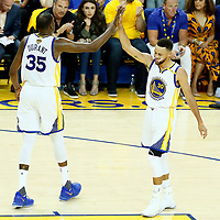 01 June 2017: Golden State Warriors forward Kevin Durant (35) celebrates with Golden State Warriors guard Stephen Curry (30) during the Golden State Warriors 113-90 victory over the Cleveland Cavaliers, in game 1 of the 2017 NBA Finals, at the Oracle Arena, Oakland, California, USA.