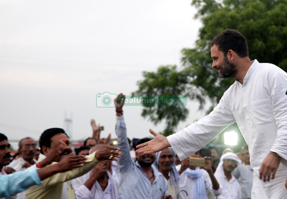 September 16, 2016 - Kaushambi, India - Indian Congress party's vice president and leader Rahul Gandhi shakes hands with local party workers during a public meeting, popularly known as Khaat Panchayats, where organizers make arrangement of thousands of Khaats (cots) for the people attending the meetings to sit on them, while listening to their leader, in tenwa village , in Kaushambi on September 15, 2016.Khaat (rustic Hindi word for cot) is symbol of villages in general and of farmers in particular. By naming the public meetings as Khaat Panchayats arranging khaats during the meetings, a strategy has been drawn to connect Rahul and Congress with the farmers of Uttar Pradesh and thus reap the electoral harvests during the next assambly elections. (Credit Image: © Ritesh Shukla/NurPhoto via ZUMA Press)