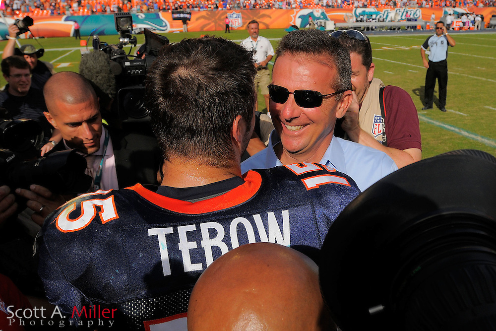 Denver Broncos quarterback Tim Tebow (15) with former University of Florida coach Urban Meyer after the Broncos 18-15 OT win over the Miami Dolphins at Sunlife Stadium on Oct. 22, 2011 in Miami Gardens, Fla. ..©2011 Scott A. Miller