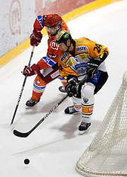 Marjan Manfreda of Acroni Jesenice vs Darcy Werenka of Graz during ice hockey match between HK Acroni Jesenice and  Moser Medical Graz 99ers in 24th Round of EBEL league, on December 3, 2010 in Arena Podmezakla, Jesenice, Slovenia.  (Photo By Vid Ponikvar / Sportida.com)