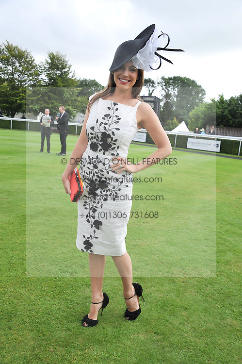 KELLY BROOK at the 3rd day of the 2012 Glorious Goodwood racing festival at Goodwood Racecourse, West Sussex on 2nd August 2012.