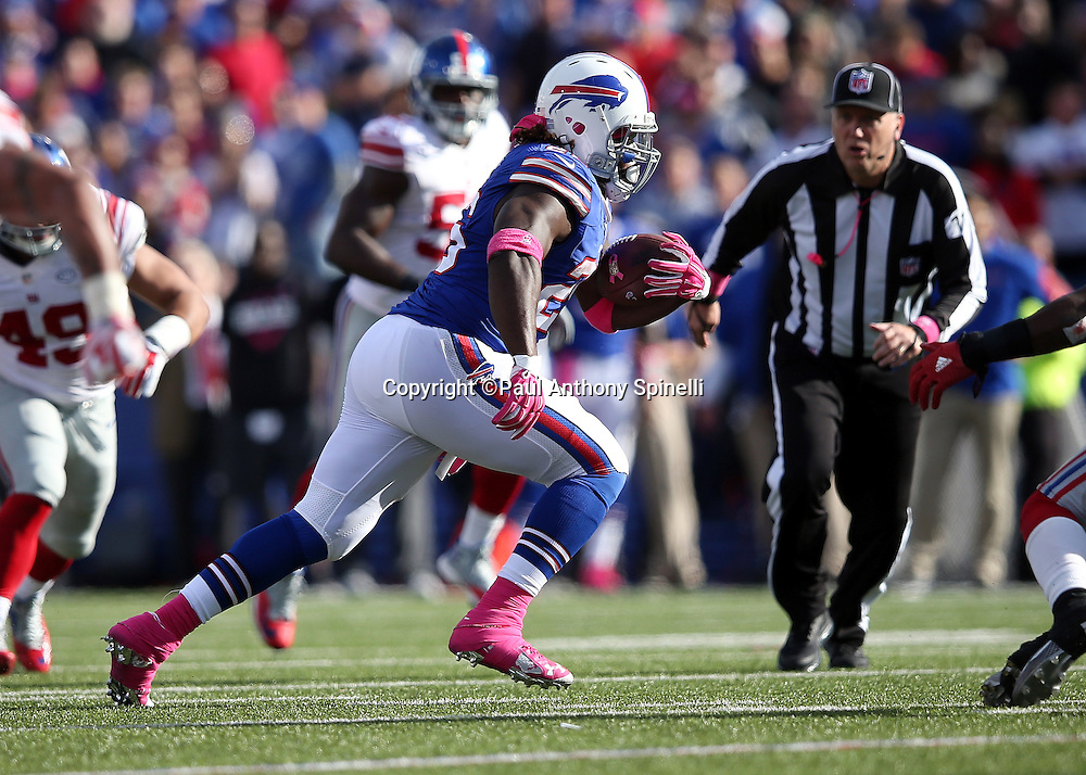 Buffalo Bills running back Anthony Dixon (26) runs with the ball after catching a pass good for a gain of 14 yards and a late fourth quarter first down during the 2015 NFL week 4 regular season football game against the New York Giants on Sunday, Oct. 4, 2015 in Orchard Park, N.Y. The Giants won the game 24-10. (©Paul Anthony Spinelli)