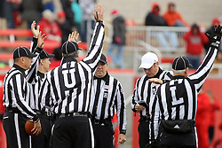 08 November 2014: The officiating crew meets at midfield before the beginning of an NCAA Missouri Valley Football Conference game between the Youngstown State Penguins and the Illinois State Redbirds at Hancock Stadium in Normal Illinois