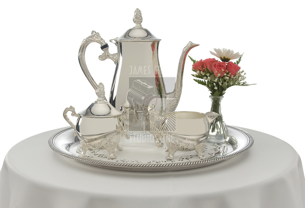 Silver tea service on a white background