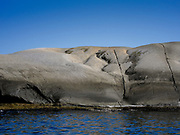 """Granite formations molded by glaciers make up for the absence of sandy beaches in Norway. Stone pots, called """"jettegryter"""" create smooth natural 'chairs"""", perfect for relaxing in and out of the water. This formation is found outside Sandefjord."""