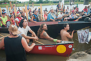 Members of Pacific Northwest tribes ask Standing Rock Sioux Reservation leaders for permission to come ashore in a ceremony upon arrival in a protest camp that sprang up to demonstrate against the Energy Transfer Partners' Dakota Access oil pipeline near the Standing Rock Sioux reservation in Cannon Ball, North Dakota. The canoe flotilla had representatives of tribes from the across the Pacific Northwest and navigated the Missouri River from Bismarck to Cannon Ball to show their support.
