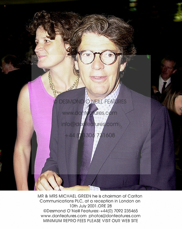MR & MRS MICHAEL GREEN he is chairman of Carlton Communications PLC, at a reception in London on 10th July 2001.	ORE 28