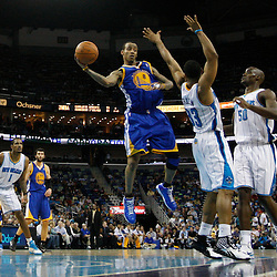 January 5, 2011; New Orleans, LA, USA; Golden State Warriors shooting guard Monta Ellis (8) passes the ball off as he is defended by New Orleans Hornets shooting guard Willie Green (33) during the fourth quarter at the New Orleans Arena. The Warriors defeated the Hornets 110-103.  Mandatory Credit: Derick E. Hingle