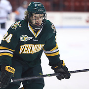 Chris Muscoby #24 of the Vermont Catamounts skates during the game at Matthews Arena on January 18, 2014 in Boston, Massachusetts. (Photo by Elan Kawesch)