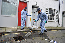 © Licensed to London News Pictures. 08/03/2019. Fulham, London, UK. Forensic officers search a drain in a sweep of Lanfrey Place where 17yr old Ayub Hassan died of stab wounds sustained in an attack yesterday afternoon. Four teenagers have been arrested in connection with the murder, the investigation continues. Photo credit: Guilhem Baker/LNP