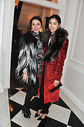 Left to right, LARA BOHINC and CAROLINE ISSA at a party to celebrate thelaunch of Alice Temperley's flagship store Temperley, Bruton Street, London on 6th December 2012.