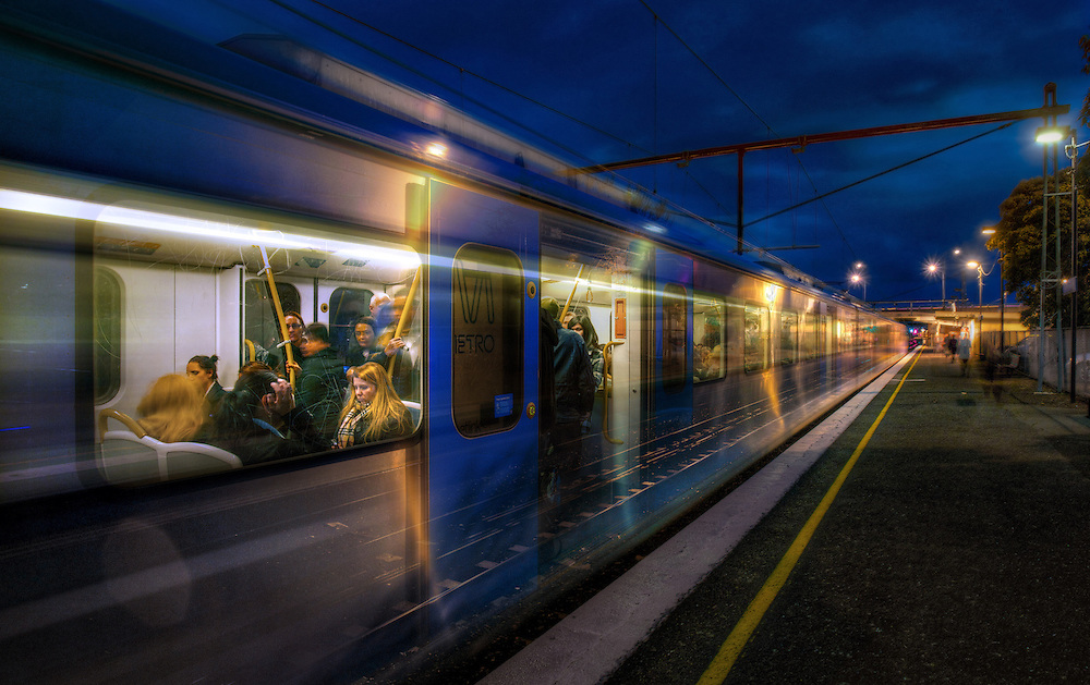 Railway Stations at night. About 6pm as a long exposure catches a train stopped at West Footscray station and then moving away at speed. Pic By Craig Sillitoe CSZ/The Sunday Age/The Age iPad App.15/6/2011 This photograph can be used for non commercial uses with attribution. Credit: Craig Sillitoe Photography / http://www.csillitoe.com<br />