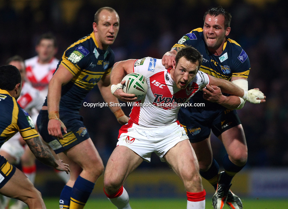 PICTURE BY VAUGHN RIDLEY/SWPIX.COM - Rugby League - Super League - Leeds Rhinos v St Helens Saints - Headingley, Leeds, England - 21/05/12 - St Helens James Roby is tackled by Leeds Darrell Griffin.