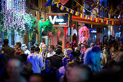 "© Licensed to London News Pictures . 22/08/2014 .  Manchester , UK . The scene on Canal Street as the evening wears on . Manchester Pride "" Big Weekend "" in Manchester's "" Gay Village "" today ( 22nd August 2014 ) . Photo credit : Joel Goodman/LNP"