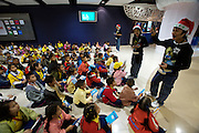 Siam Ocean World aquarium at Siam Paragon shopping center. Guides with Santa Claus hats play a quiz with school kids.