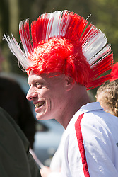 © Licensed to London News Pictures. 23/04/2015. Nottingham, UK. The Nottingham St George's parade took part today. The parade met in Forest Recreation Ground. An estimated two hundred people with trucks playing patriotic music and horses dressed in flags made their way along the streets into the City Centre. Pictured, a patriotic headdress. Photo credit : Dave Warren/LNP