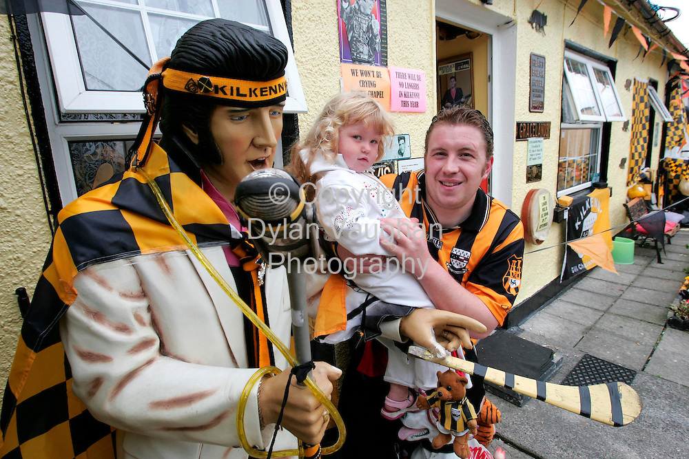 31/8/2006.Myles Kavanagh Jnr and Faith Kavanagh aged 3 pictured with a statue of Elvis in the Kilkenny colours at their home in Kilkenny..Picture Dylan Vaughan