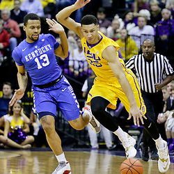 Jan 5, 2016; Baton Rouge, LA, USA; LSU Tigers forward Ben Simmons (25) drives past Kentucky Wildcats guard Isaiah Briscoe (13) during the first half of a game at the Pete Maravich Assembly Center. Mandatory Credit: Derick E. Hingle-USA TODAY Sports