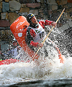 SHOT 6/4/11 5:49:22 PM - Dustin Urban of Buena Vista, Co. pops out of the water while attempting a loop during the 10th Annual Teva Mountain Games in Vail, Co. Urban won the Kayak Freestyle event with a score of 940. Professional and amateur outdoor adventure athletes from the Vail Valley and around the world will converge upon the mountains and rivers of Vail to compete in eight sports and 23 disciplines including: x-country, freeride, slopestyle and road cycling, freestyle, 8-Ball, sprint and extreme kayaking, raft cross, World Cup Bouldering, stand up paddle sprint and surf cross, as well as trail, mud and road running, dog comps and the GNC Ultimate Mountain Challenge.. (Photo by Marc Piscotty / © 2010)