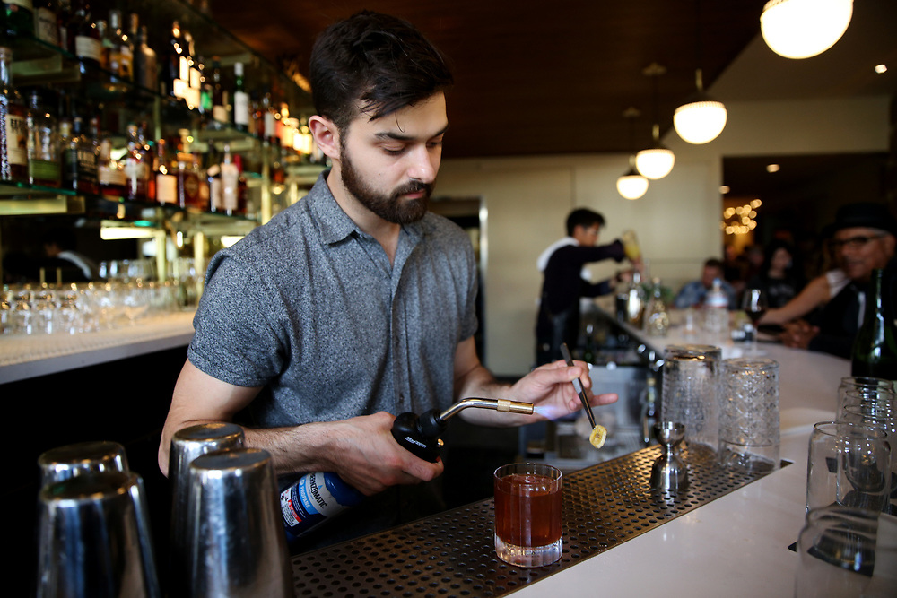Emilio Salehi makes the Hound Dog drink at The Beehive, Saturday, May 5, 2018, in San Francisco, Calif. It's located at 842 Valencia Street.
